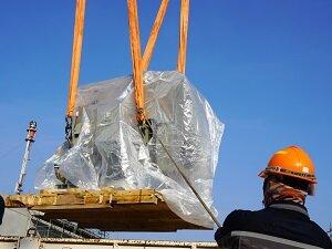 Worker Watching Crane Lift Heavy Load