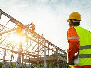 Construction Supervisor Wearing Safety Vest, Observing Construction Site