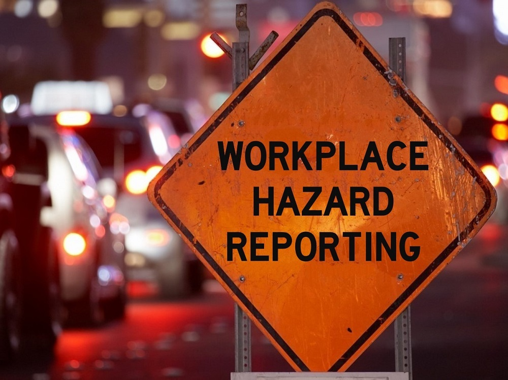 Work Zone Warning Sign That Says Workplace Hazard Reporting