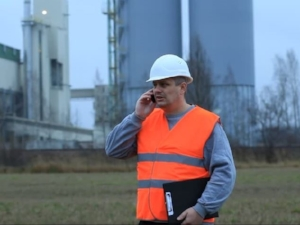Construction Supervisor Calling in a Hazard Report on Cell Phone