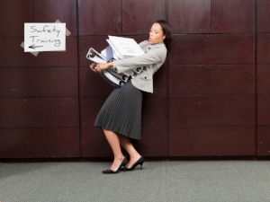 Woman Carrying Large Binders to Safety Training