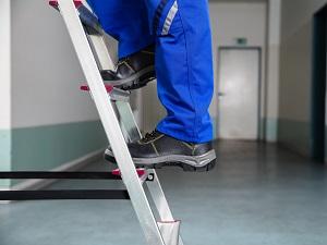 Workers Legs, Feet Standing on Step Ladder