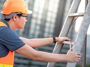 Construction Worker Climbing Step Ladder