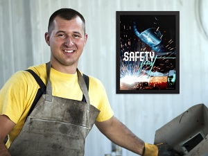 Welder in Front of Safety First Poster