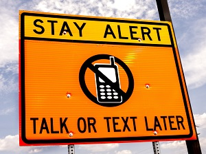 Orange Warning Sign, Stay Alert, Talk or Text Later