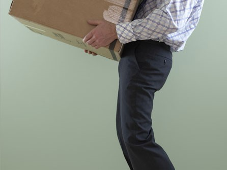 Man Lifting a Box