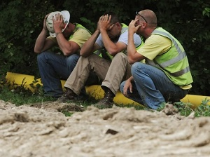 3 Sad Construction Workers Sitting