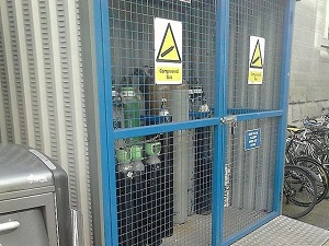 Compressed Gas Canisters Locked in Outdoor Cage