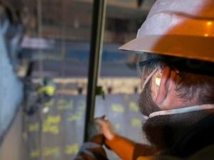 Worker Wearing Ear Plugs