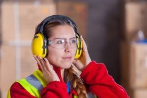 Woman at Work Wearing Hearing Protection