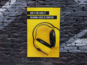 Hearing Protection Poster on Black Brick Wall
