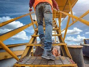 Worker Walking up Fixed Stairs