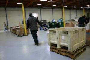 Worker Pulling Pallet Jack