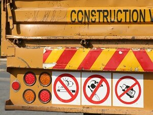 No Cell Phone Sign, Back of Construction Vehicle