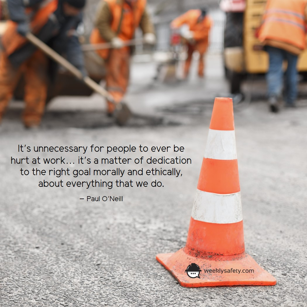 Road construction workers, orange and white construction cone