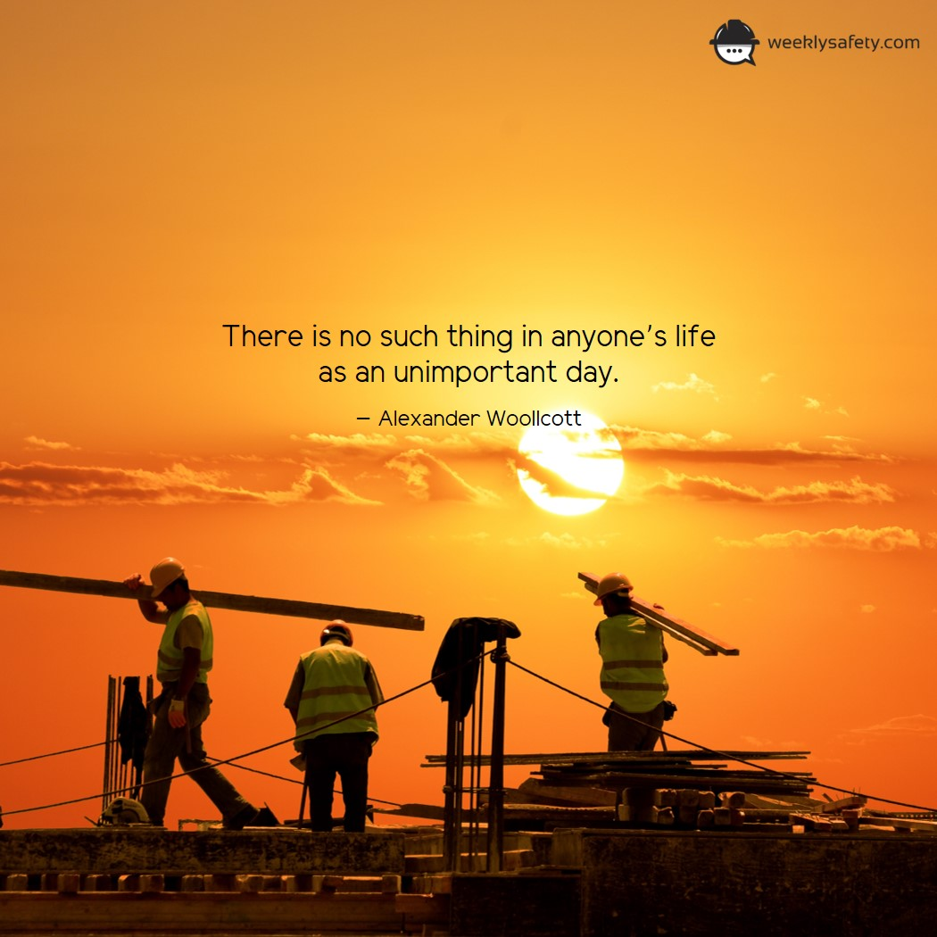 Silhouette of Construction workers, yellow and orange colored sunset sky.