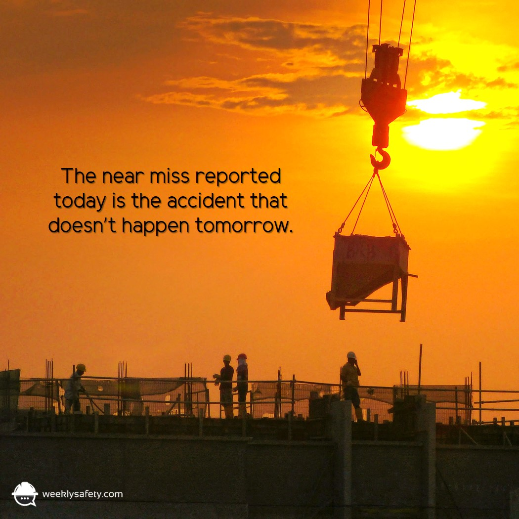 Silhouette of construction site with crane lifting equipment on a bright sunset.