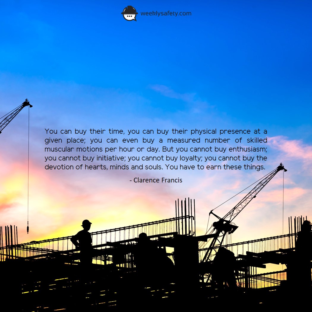 Silhouette of construction site with crane lifting equipment on a bright sunrise morning