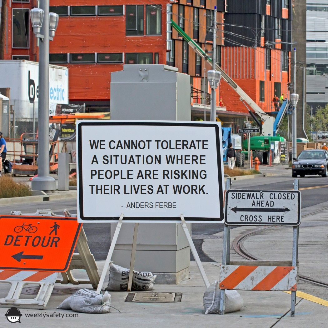 Construction work area with road signs, traffic equipment, and warning signs