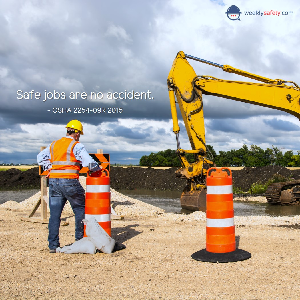 Construction worker standing in front of an excavation machine
