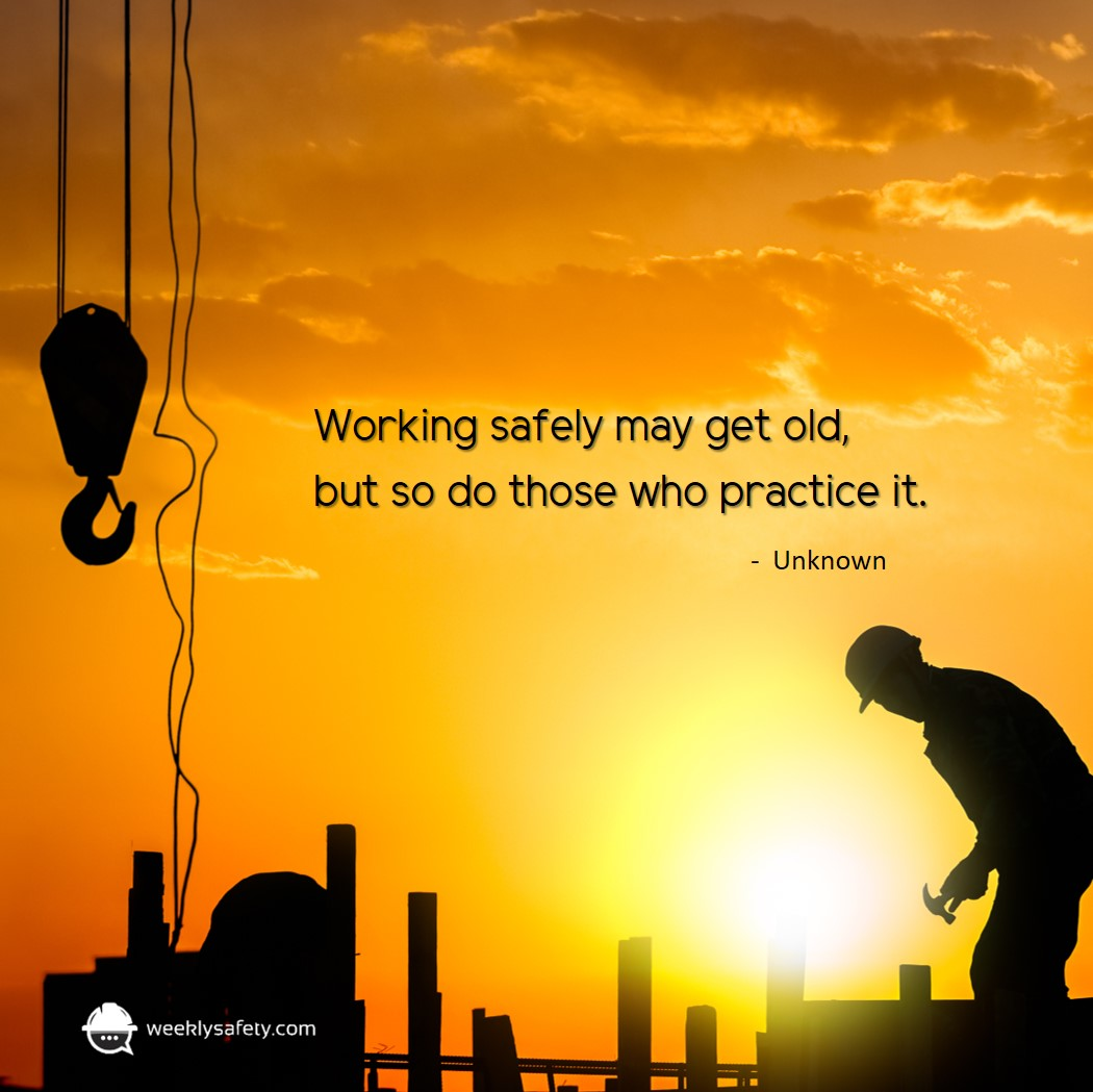 Silhouette of lone construction worker on a yellow and orange sunset