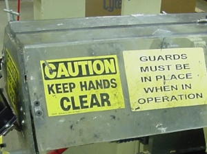 machine with warning labels on guard