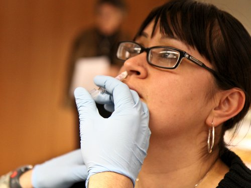 Woman Getting Nasal Spray Flu Vaccine