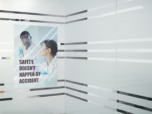 Safety Poster on Glass Wall