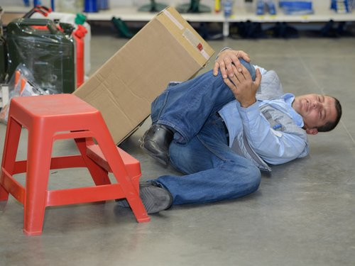 Warehouse Worker Tripped., Grasping at Hurt Knee