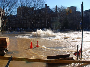 Broken water main flooding busy intersection