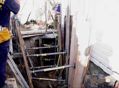 The cave-in protection seen here was only installed after the fatal collapse so that the deceased worker could be safely be removed.
