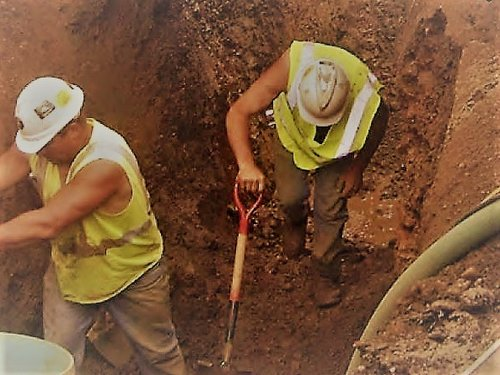 Two Workers in a Trench