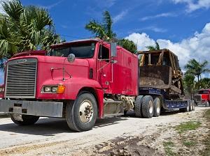 Big Truck Hauling Front End Loader