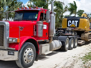 Big Truck Hauling Exavator
