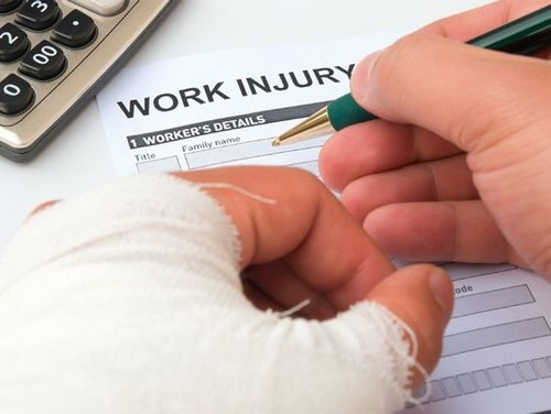 Injured Worker Filling Out Injury Claim Form