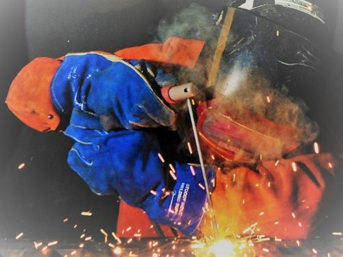 Welder Wearing Gloves
