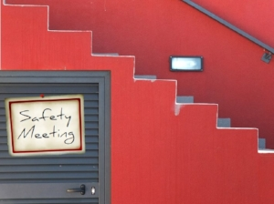 Red Wall, Stairs, Sign on Door Says Safety Meeting