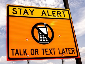 Road Sign, Stay Alert, Talk or Text Later