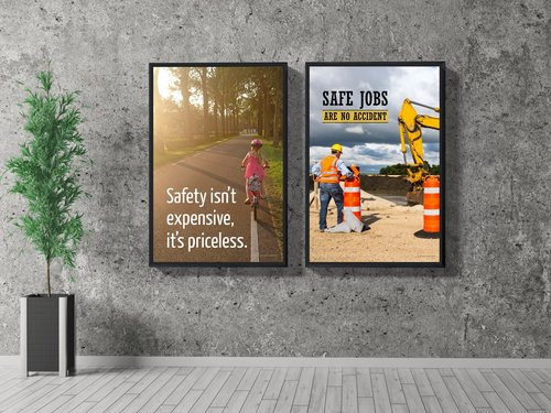 Two Framed Safety Posters Hanging in Lobby