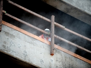 Construction Worker Creating Dust