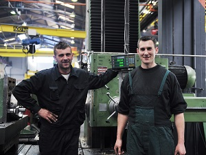 Two Workers in Industrial Workspace