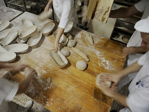 Bakers Preparing Bread to Bake in Bakery