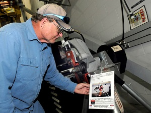 Leon Berry, millwright, checks the lock out tag out procedure on a roll grooving tool in the pipe shop.