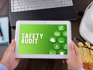 Worker Holding iPad with Electronic Version of Safety Audit