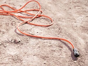 Extension Cord Laying in the Dirt