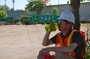 Worker Drinking Water in Shade