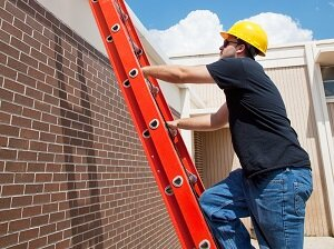 Construction Worker Climbing Extension Ladder