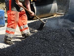 Road Workers Laying Asphalt