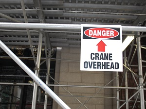 Danger, Crane Overhead, Sign at Construction Site