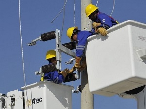 Workers receive training in safe operation of bucket trucks and power line work.